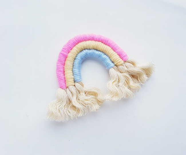All 3 ropes have been glued to felt. Fluff out the ends of each rope on the macrame rainbow charm.