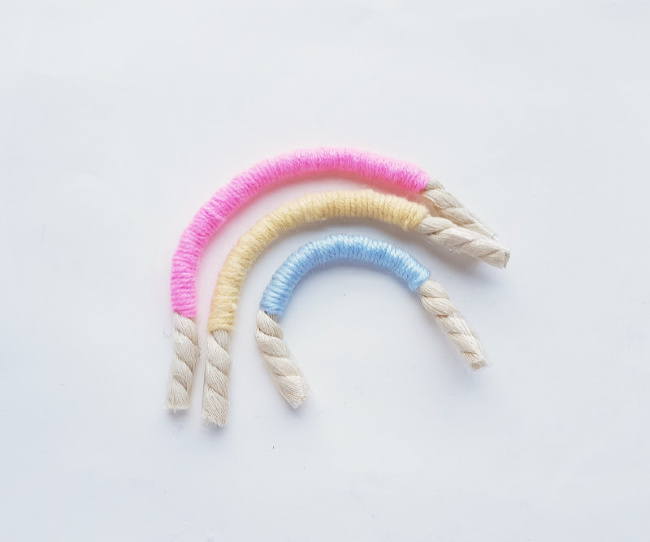 showing 3 completed colors of macrame rainbow craft