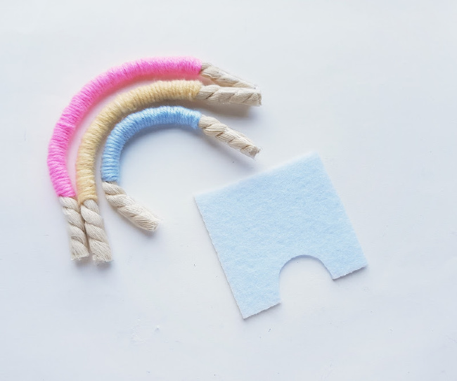 cutting a piece of felt for the backing of the macrame rainbow